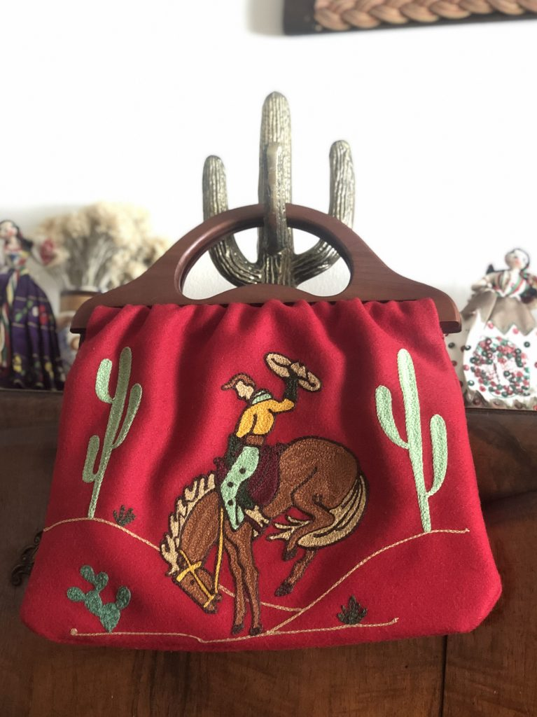 Red cowboy purse with chainstitch embroidery by Tina Vines
