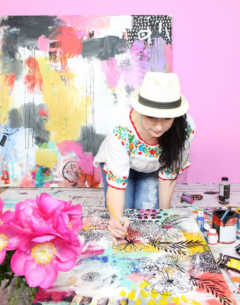 Artist Alisa Burke working in her studio